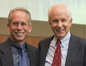Douglas Diekema, MD, MPH (left), with Dr. Fost at the department's first Annual Lecture in Bioethics.