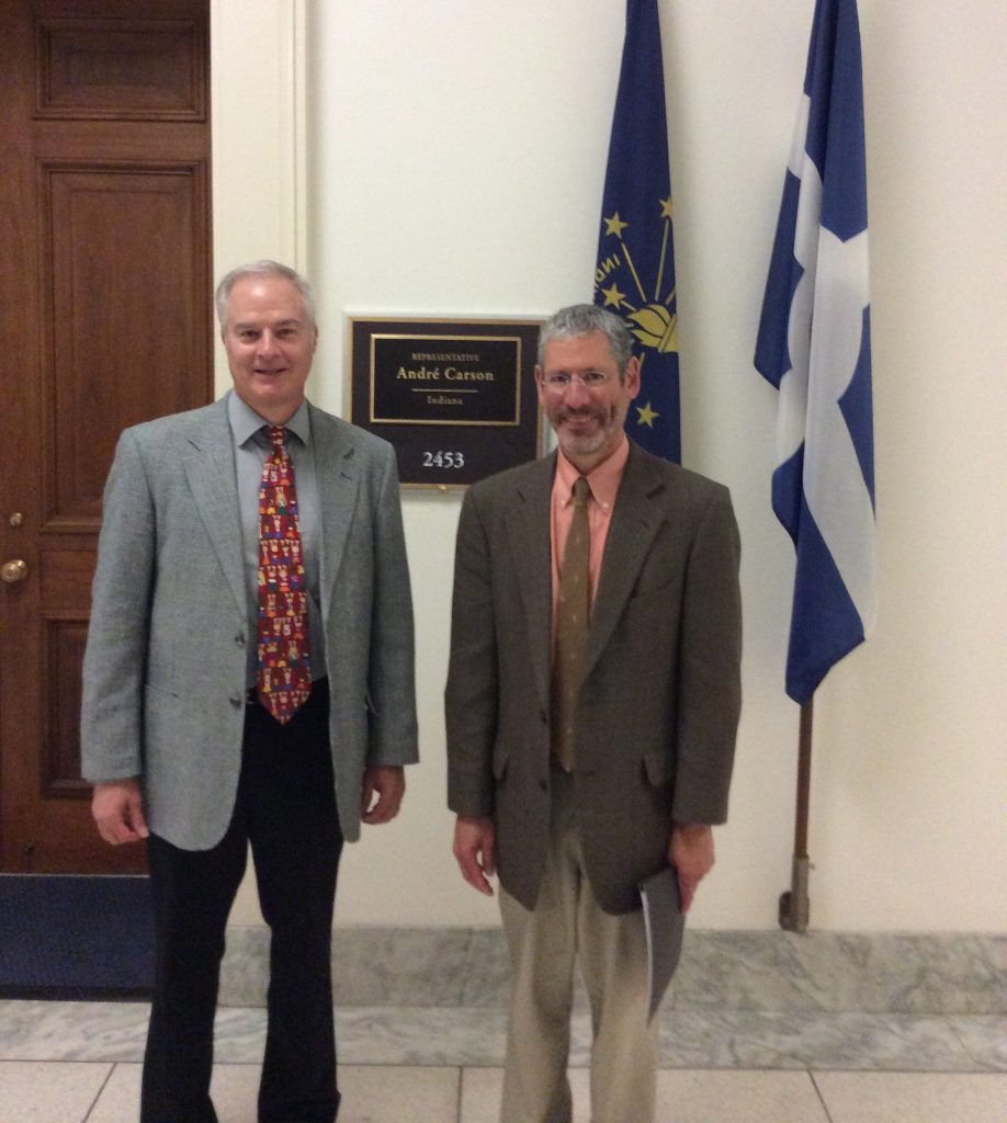 Above, Dr. Conway and colleague Dean Blumberg, MD, visited Washington, DC, in July 2014 to advocate for worldwide vaccine access.