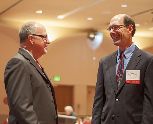 Marc Williams, MD, FAAP, FACMG, director of the Genomic Medicine Institute at Geisinger Health System, talks with David Wargowski, MD, at Seminars in Pediatrics.